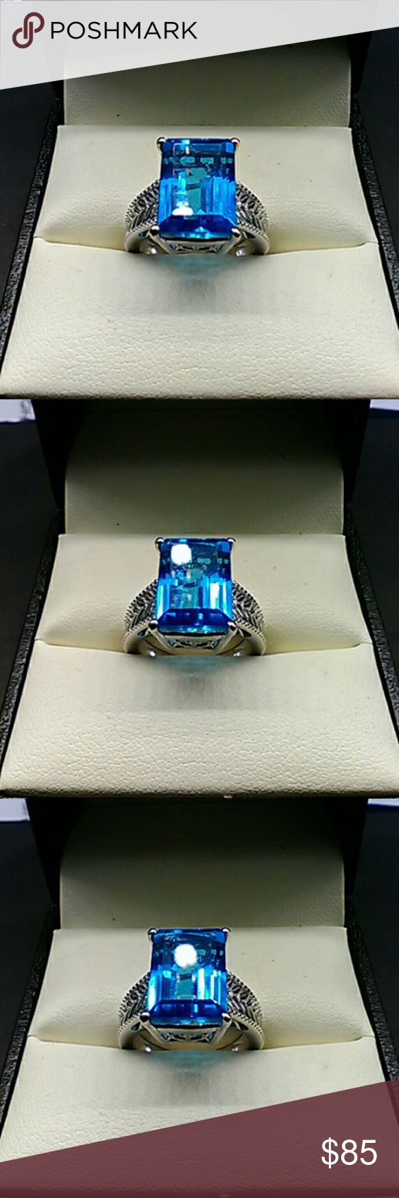 9cts Genuine Caribbean Blue Quartz 925 Silver Retail Price:$389 Flash Sale: $85 Beautiful large sterling silver statement ring. Genuine natural 9 carat Caribbean Blue Quartz.  Platinum over solid 925 sterling silver artisan ring. Size 7 estate 925 Jewelry Rings