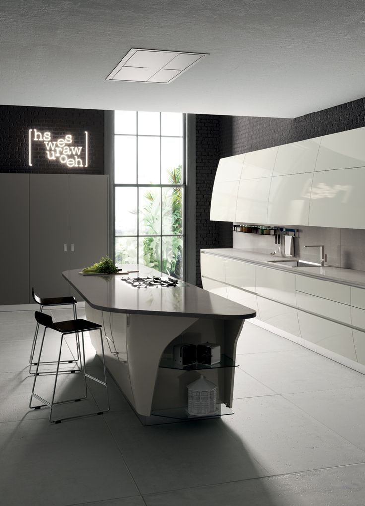 The clean-cut silhouette of the new shaped island, in Pearl Breeze Quartz, along with the exclusive curved end units, enhance the uber-modern and sophisticated design of the Flux Swing project.