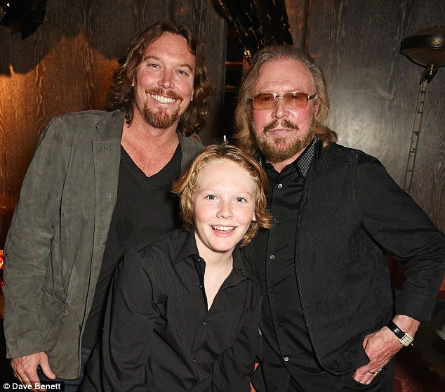Barry Gibb, 69, (right) posed with his son Ashley and grandson Lucas at a music party in M...