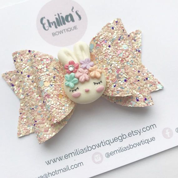 Double Glitter Fabric Bow in Pastel Colours with a sleepy Bunny Clay Charm. Each Bow measures 3 1/4 inches wide and can be put on a coordinating Elastic for Babies, a Nylon Dainty which is one Size fits all or an Alligator Clip. Please refer to the photos in this listing when