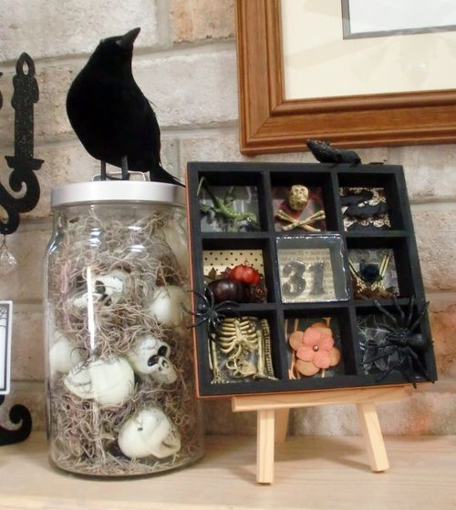 Make a Halloween Shadow Box (*Like the jar of skulls with the raven on top, too.)