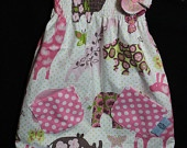 Beautiful Girls Reversible Hello Kitty Pinafore  Dress age 3-4  With Scrunchie and Hair Clips By Dimplebum. $45.00, via Etsy.