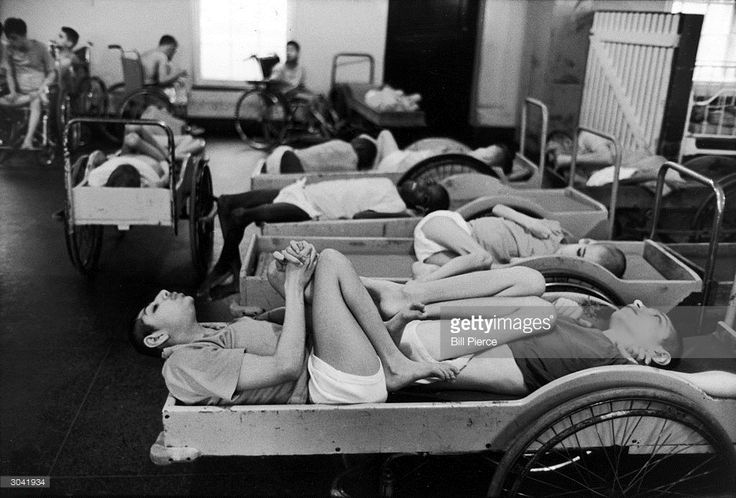Young patients sleep, curled up in carts, in Building #29 at Willowbrook State School, Staten Island, New York, January 1972. After the appaling conditions at the facility, ostensibly an instituation to help mentally handicapped patients, were made public, widespread outcry led to its closing.