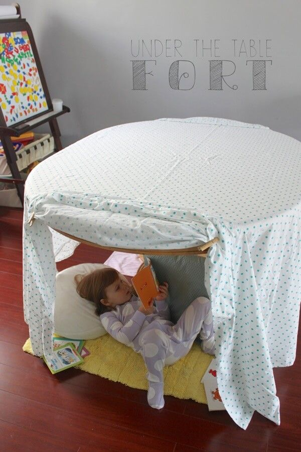 A fort under the table can be simple or complicated.  But either way it will lead to hours of fun.  Here are 7 DIY indoor play forts for kids!