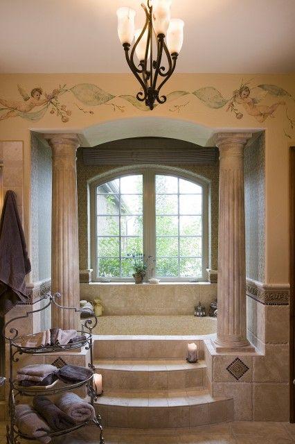 Beautiful Roman style bath, with an alcove tub framed by pillars, accessed by marble steps (via Design Associates - Lynette Zambon, Carol Merica).