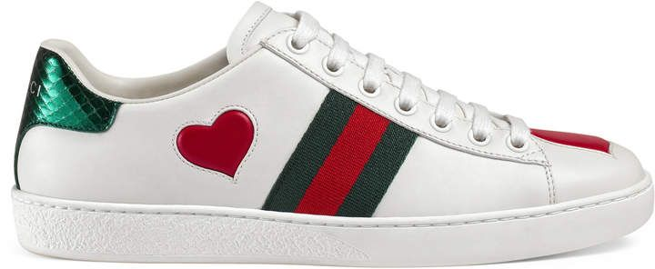 30982d4a1 Gucci Ace embroidered sneaker. Our classic low-top sneaker with Gucci's  iconic Web with two leather hearts sewn into the shoe.