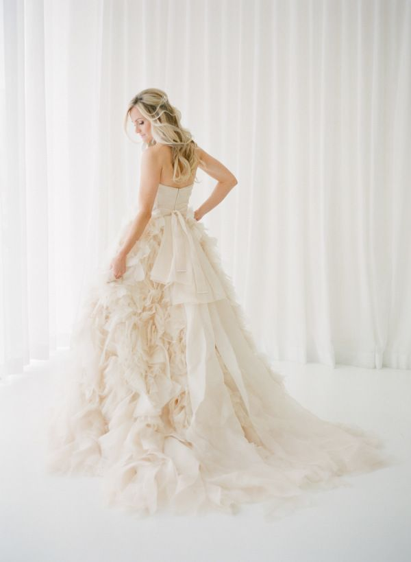 We've shown you some of our favorite jaw-dropping pink wedding dresses from the SMPLookbookand this pastBridal Week, but what about some serious inspiration from what we do best: Real Weddings.We poured through thearchives to find the prettiestpink wedding dresses soyou canbe inspired to embody the ultimate blushing bride on your Big Day. Take a peek!
