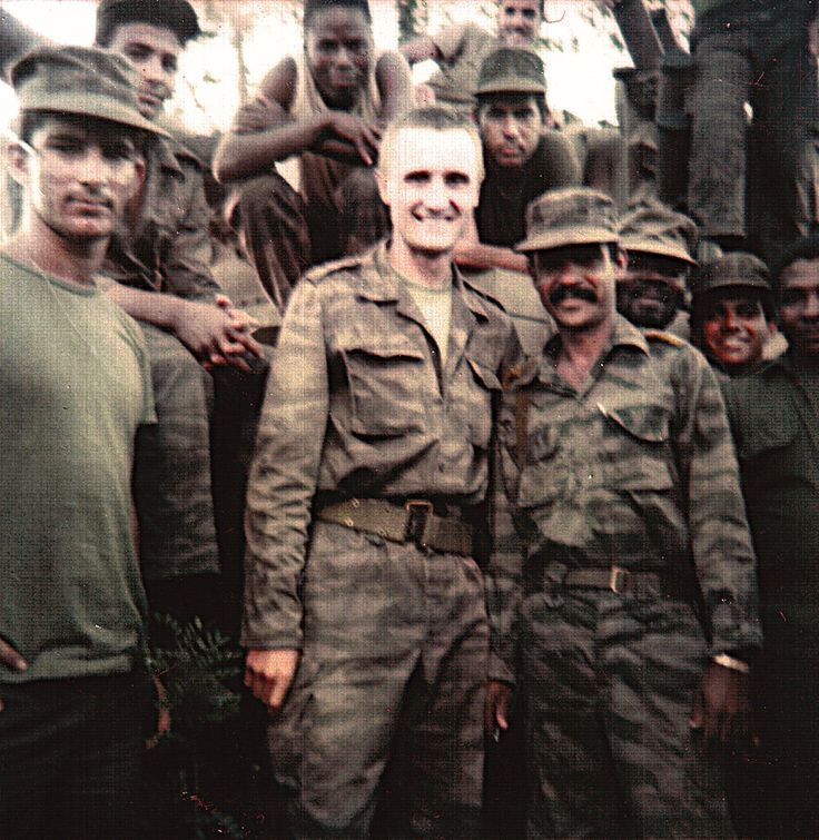 Angolan, Soviet, and Cuban soldiers pose for a group photograph near Cuito Cuanavale. Photograph taken in April 1988.