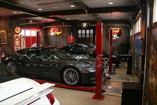 Custom garage design and furnished by vault by for Custom garage design