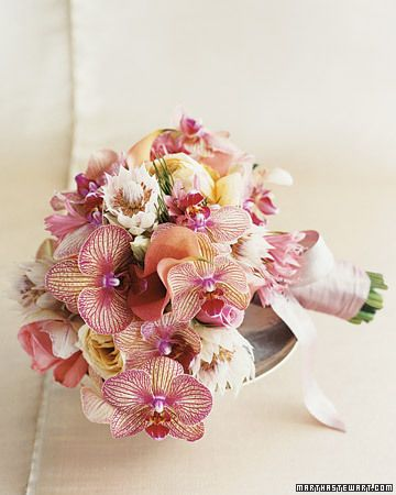 Their bouquets, by florist Matthew Robbins, feature calla lilies, phalaenopsis orchids, blushing brides, nerines, and garden roses    Read more at Marthastewartweddings.com: East Coast Real Weddings -- Martha Stewart Weddings