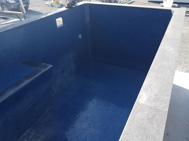 Ocean blue ceramic tiles Mid grey granite coping