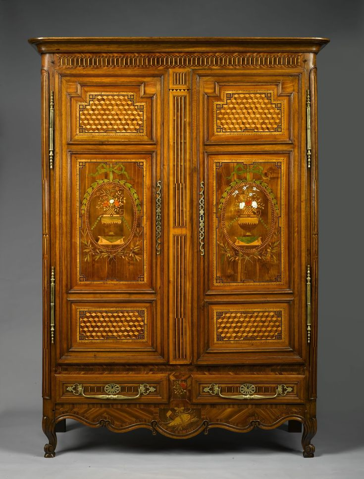 An exceptional and rare French, late 18th century, fruitwood armoire from Lorraine with marquetry flower vases and ivory inlay between two areas with cube marquetry