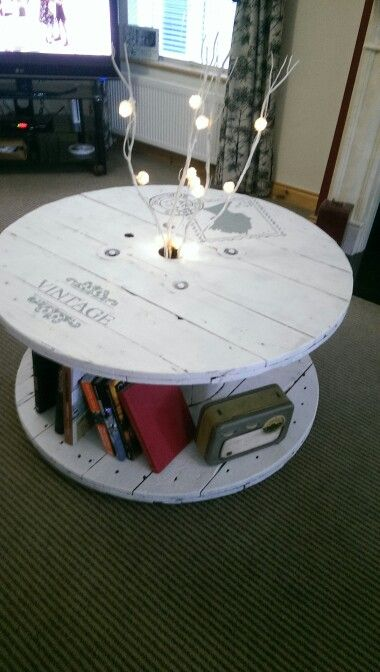 Cable drum coffee table with stenciljng and branched lighting