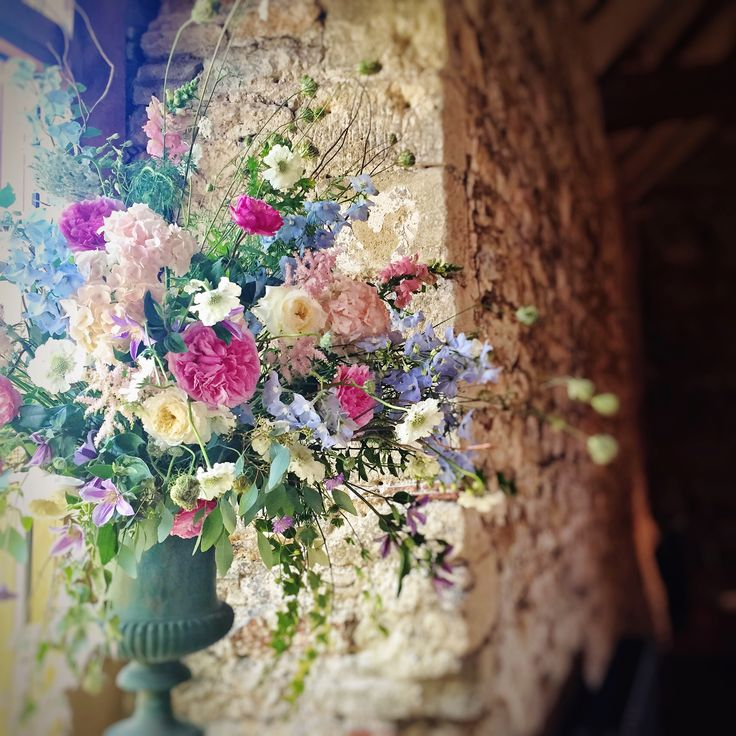 Urn design for a summer English country wedding reception at Notley Abbey