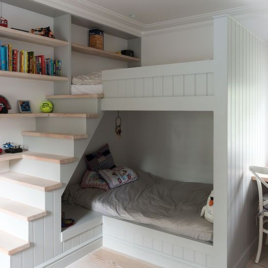 This children's room has a modern look with tongue-and-groove panelling and pale wood flooring, but stars of the show are the innovative built-in bunk beds, which incorporate a den-like lower bunk, a top-of-the-world upper, plus mini staircase (don't insult us with a ladder!) and integrated book shelving.