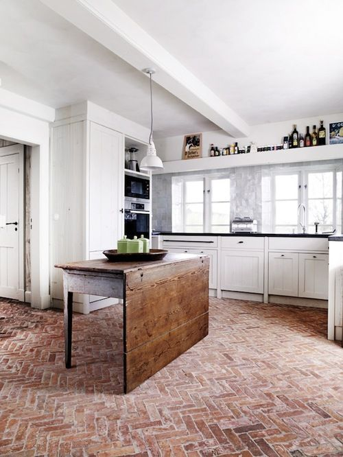 loving the brick floor in this white, simple kitchen