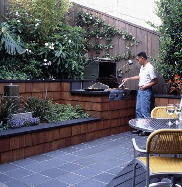 Grilling Patio...Nestling a built-in barbecue amid rich plantings makes for a more inviting dining area. Counter space was included next to the grill as a landing spot for hot plates. Note also that a lamp with a flexible neck is attached to the adjacent fence. This puts bright light where the cook wants it when barbecuing steaks after dark.