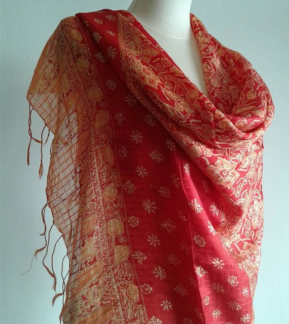 Check out this item in my Etsy shop https://www.etsy.com/listing/258444258/red-scarf-hand-printed-orange-batik-silk