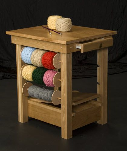 Solid Cherry Wood Knitting / Crochet Table - removable spindles for yarn, small drawer for notions, and hollow bottom area for larger things. Table has edges for attaching yarn winders and swifts. Saw them in person - really nicely made.