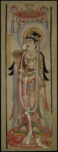 Banner of a bodhisattva standing under a canopy on a lotus. Tang dynasty, 851-900. Dunhuang,Qian Fo Dong (Caves of the Thousand Buddhas). Painted in ink and colours on silk. © The Trustees of the British Museum.