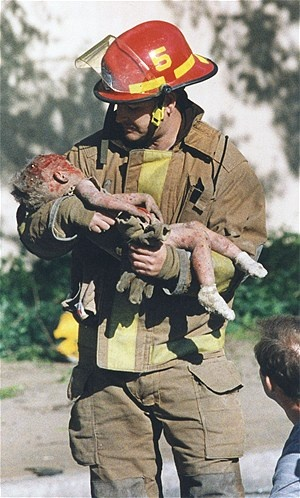 Oklahoma City firefighter Chris Fields carries a baby, Angel Baylee Almon, who was in a daycare center at the Alfred P. Murrah Federal Building when it was bombed on April 19, 1995. Angel was one of 168 people killed in the blast, including 19 children under the age of 6.