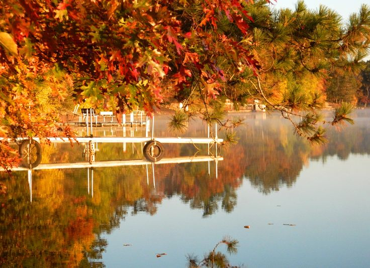 Dockside on the Wisconsin Fall Color Report. Fog clearing away on a placid lake makes for a spectacular morning.