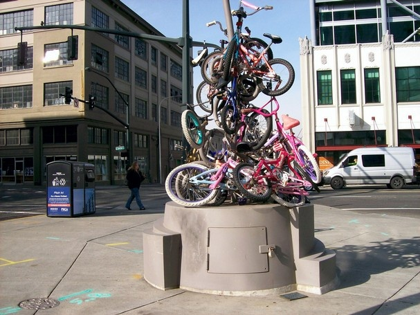 A bike sculpture sits at Burnside and 13th Avenue in Portland, Ore. The city's Pioneer Square is a gathering place, a prime spot for people-watching, al fresco lunches and free entertainment.