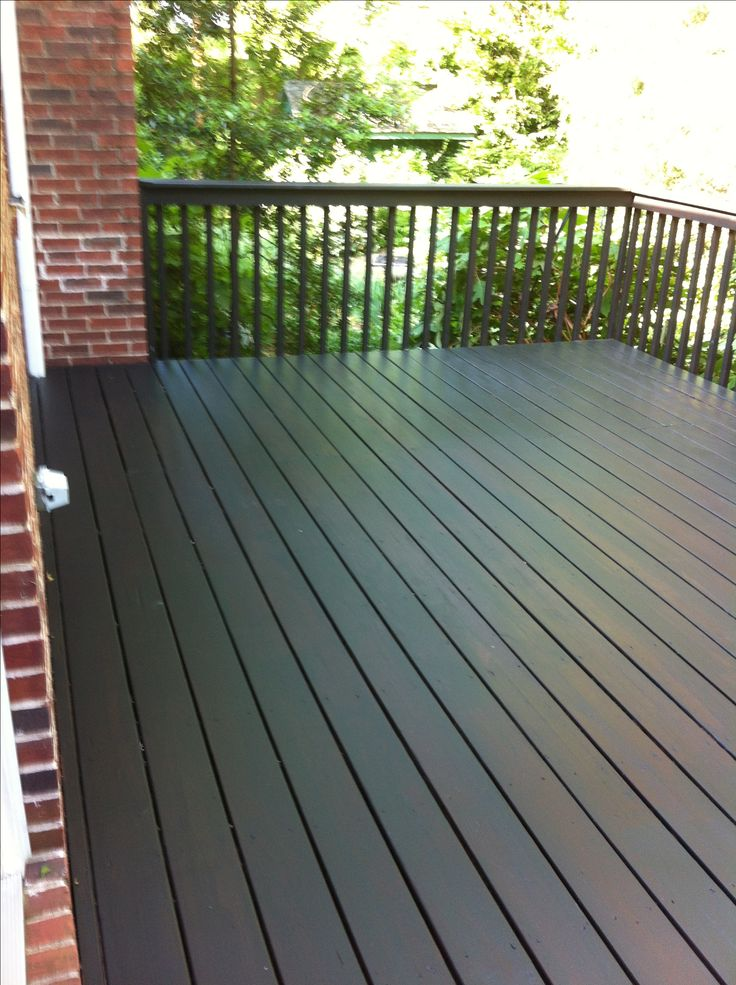 "We wound up using Behr solid stain in Slate. We chose it because of its scores on a Consumer Reports test and we generally have had good results from Behr products. Our deck ""after"" painting. We liked the effect of the old Behr semi-transparent Redwood color showing through, so we left it."