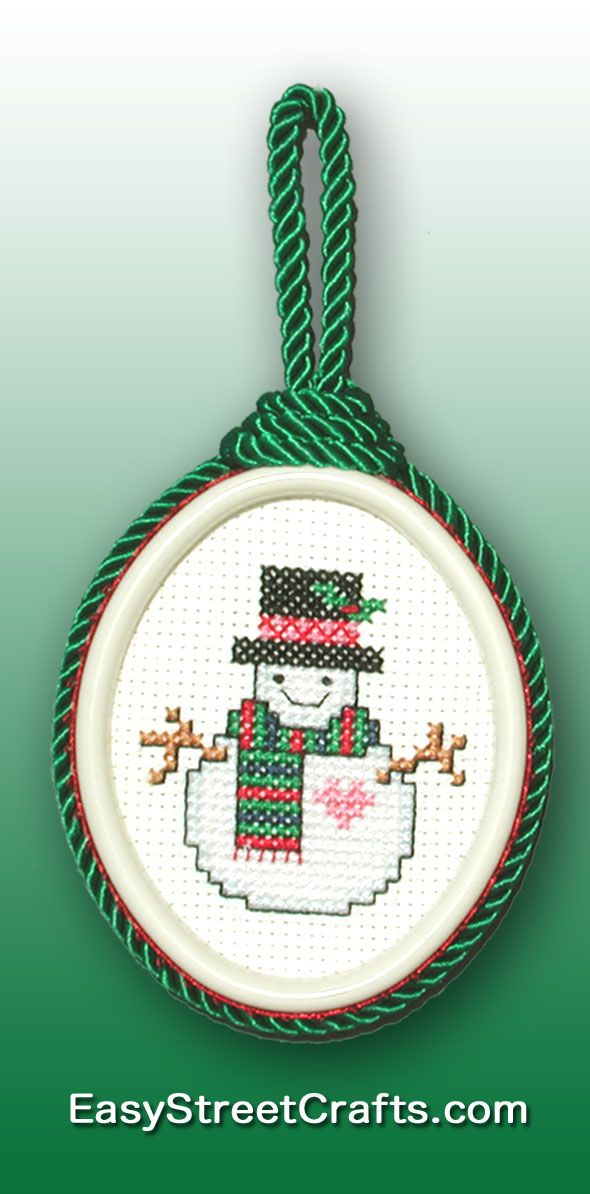 "THIS SNOWMAN IS KEEPING WARM WITH HIS RED AND GREEN KNITTED SCARF Cross-stitch Chart is in ""Stitch Christmas Ornaments All Year 'Round"" booklet. EasyStreetCrafts.com"