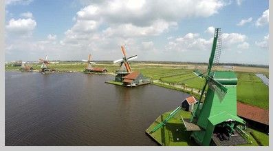 Windmill/ Wind Turbine photo of the dayGreen windmill of Zaanse Schans is one of most popular tourist attractions in the Netherlands Holland near Amsterdam.