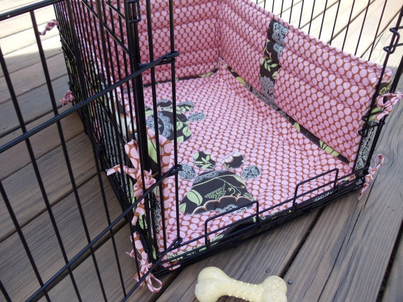 Dog crate pad and bumper pads.  Our dog does need bumper pads but like the idea of a mat that stays put