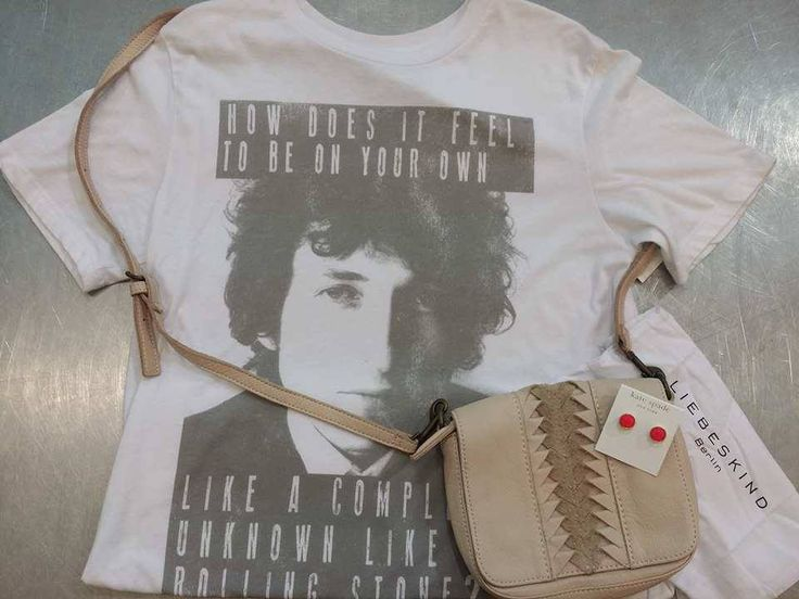 Hit that summer concert series with the best in vintage-style tees & accessories – Find this cute #BobDylan graphic tee & more at #PlatosClosetBrampton! //tee, $8//#KateSpade studs, $20//#liebeskind purse, $75// | www.platosclosetbrampton.com