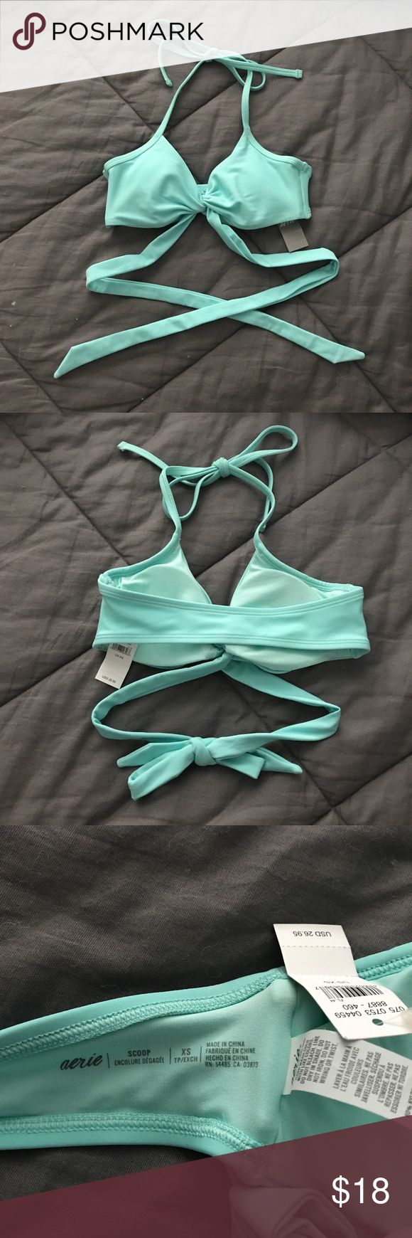 Aerie wrap around / cross body bikini In a light blue/mint color, similar to a seafoam color or Tiffany Blue! Super cute swimsuit top that has straps that wrap around and tie in the back! Size XS, just too small for me. NWT, never been worn! aerie Swim Bikinis