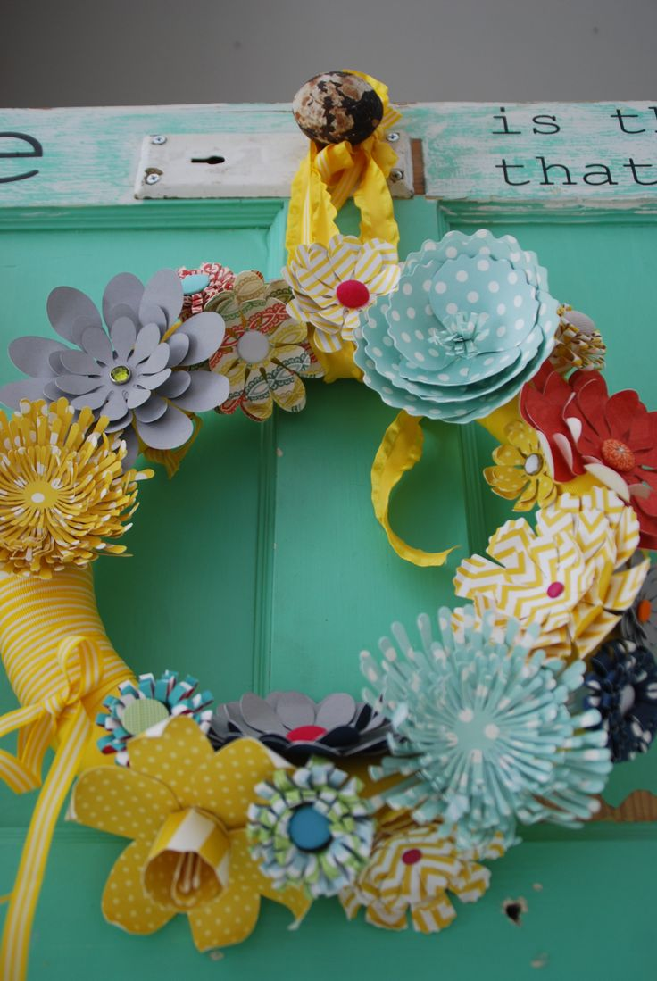 This post features a wreath but the real highlight is the list of links to make the various paper flowers on the wreath