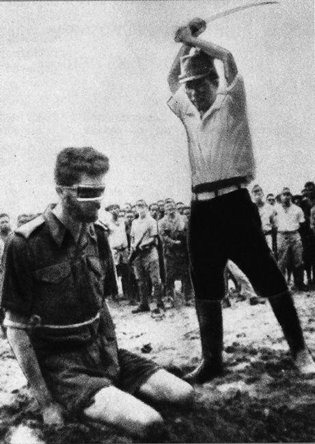 COWARDICE An Australian POW, Sgt.Leonard Siffleet, captured in New Guinea, about to be beheaded by the Japanese with a shin guntōsword, 1943.