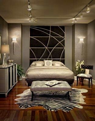 Master bed, glam like the color scheme, not so much the glam