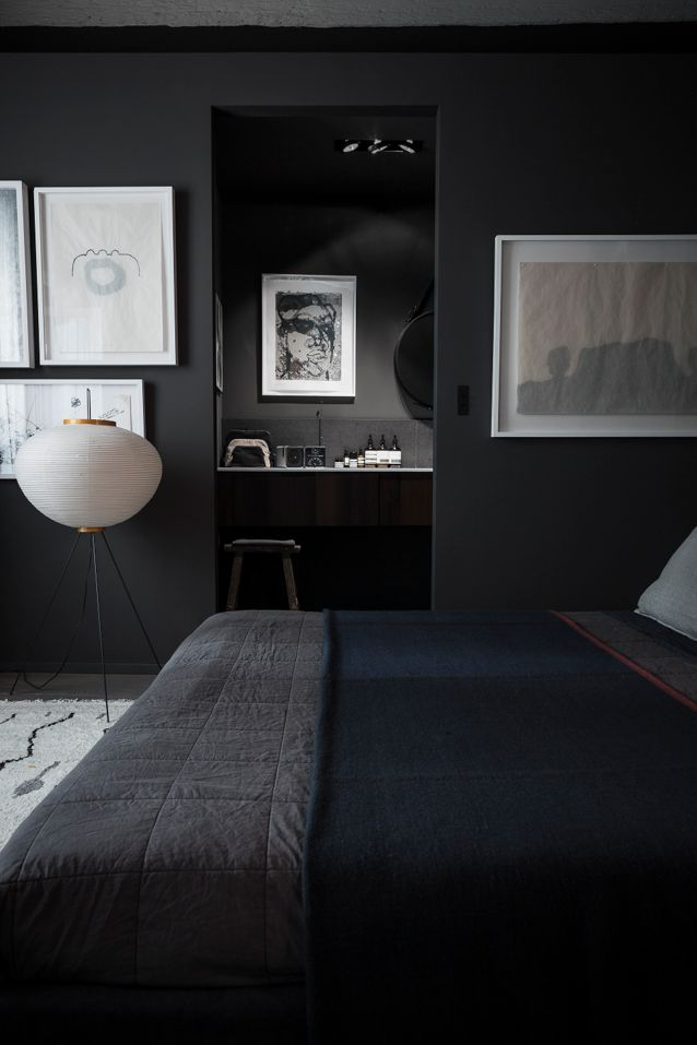 Black Bedroom With A Japanese Style Lamp.
