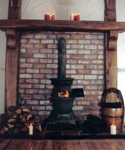 Reclaimed Timber Oak Fireplace Mantel Beam, Reclaimed belfast Brick, Cast Iron Pot Belly Stove, Reclaimed Red & Black Quarry Tiles