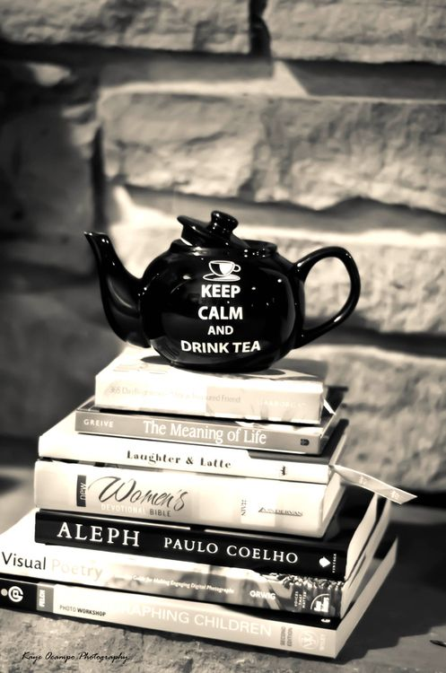 Another pile of books -- with an interesting teapot (or other piece of crockery). #bibliophilewedding