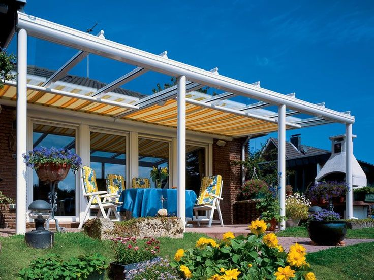 Large glass veranda with extendable awning colourmatched