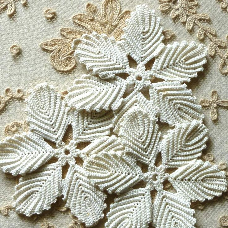 http://vintagepassementerie.com/products-page/vintage-appliques/antique-hand-made-lace-flowers-two-patterns/