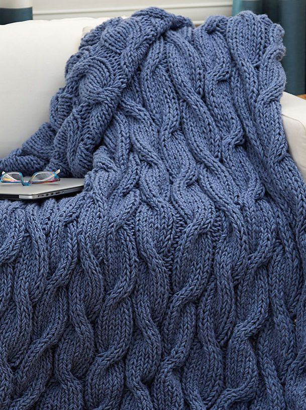 Free Knitting Pattern for Easy Quick Casual Cables Throw - This easy afghan is a quick knit in bulky yarn that also gives the cables a softer, flowing look. Designed by Laura Bain