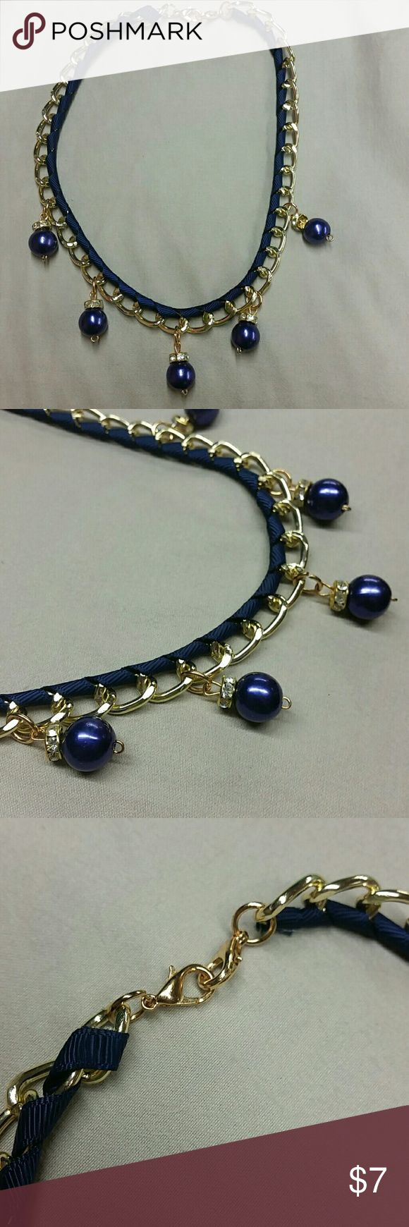 """Gold, blue gothic victorian pearl choker necklace Thick gold chain, dark blue ribbon weaved through it. Dark blue faux pearls with a gold colored cubic zirconia encrusted bead. 2 clasps. 17"""" long  This came attached to a shirt that I no longer have. Not really into it.  Goth, emo, Victorian, steampunk, rave, costume,  junk jewelry,  punk unknown  Jewelry Necklaces"""