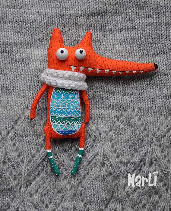 Love those teeth, the scarf, and the patterns.   Lidiya Marinchuk's Snow fox