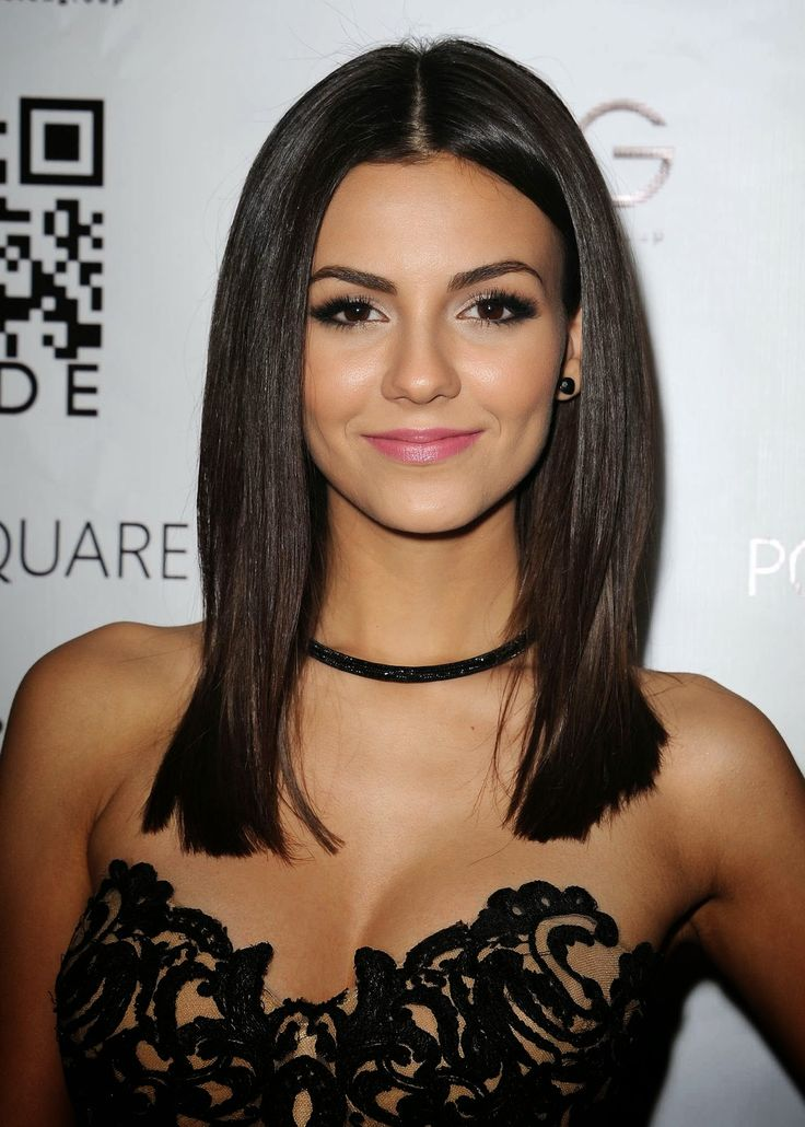 Victoria Justice stuns in a revealing lace catsuit at the Kode Mag Spring 2015…