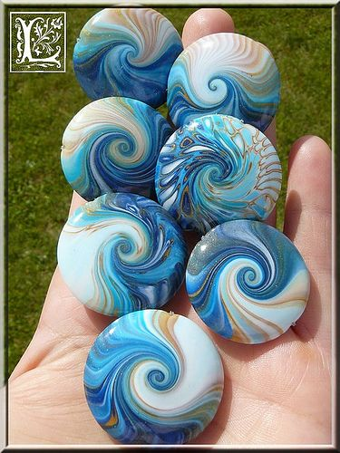 Swirled lentil beads made from polymer clay by Lolo60W.