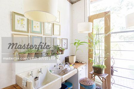 Wall hangings and lights over rustic kitchen sink – Image © Masterfile.com: Creative Stock Photos, Vectors and Illustrations for Web, Mobile and Print