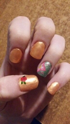 Orange and green accent nails  with flowers