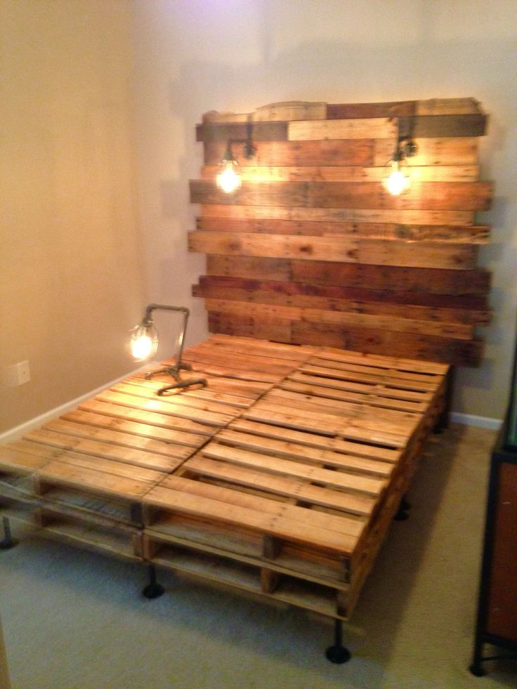 Pallet bed with Edison builds and birdcage light frames