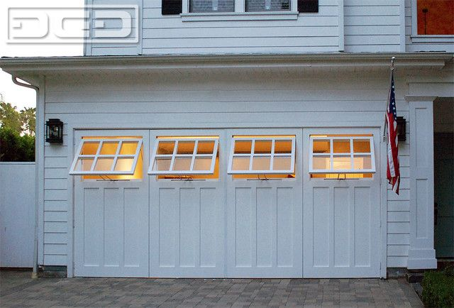 <b>Out-swing real carriage garage doors</b> are popular in <b>garage conversions</b> throughout the <b>Los Angeles</b> and Southern California region. <b>Carriage doors</b> offer convenience functionality and architectural beauty. <br><br>This <b>custom-made carriage door</b> features fully functional <b>awning windows</b> that crank open individually. The glass in the windows is partitioned with true dividing mullions as you would expect from the traditional craftsman standards. The design…